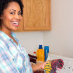 10 Simple Steps to Get Laundry Done Right - woman doing laundry