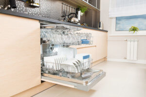 Built-in dishwasher full of clean dishes. Difference between dishwashers