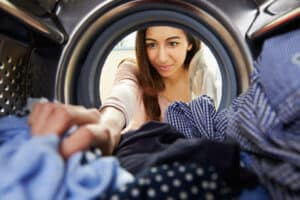 Thinking Outside the Hot Box - Girl Reaching Inside Drying Machine